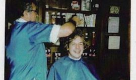 Andrew Creager getting a haircut for the high school swim team.