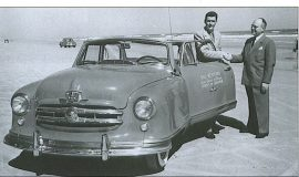 Bill Rexford (left) accepts the keys to a 1951 Nash Rambler for winning the NASCAR championship in 1950.