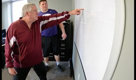 Former NFL coach Bob Palcic quizzes K-State's B.J. Finney about blocking schemes at Simoneau Sports Performance in Overland Park, Kansas on February 10, 2015 during preparations for the NFL Scouting Combine.