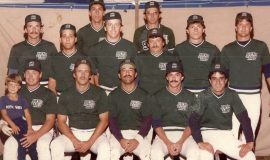 1984 ASA National Softball Champions front row left to right: Bob Schmitt (holding Corey Schmitt), Bob Burns, Joe Mistretta, Dan Harnish, John Mancari back row left to right: Bruce Sprankle, Rich Pinciaro, Pete Caprino, John Woodfield, Jim Brooks, Terry Woodfield, Steve Bowman, Dave Boughton.