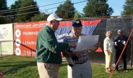 Jack Keeney shows Ron Melquist a picture of Celoron Park.