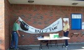 Hanging the banner.