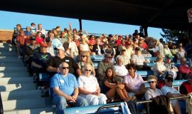 Over 100 guests fill section A of the grandstand.