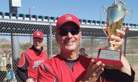 Charlie LaDuca holding the championship trophy.