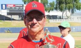 Charlie LaDuca holds the Men's Senior Baseball League World Series championship trophy.