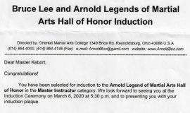 Bruce Lee and Arnold Legends of Martial Arts induction notification. 2020.