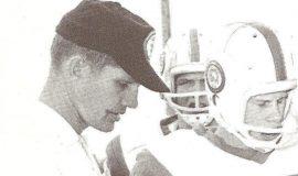 Flash Olson coaching football.