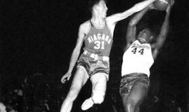 Clem Worosz blocks the shot attempt of Syracuse's Jim Brown during the 1950s.