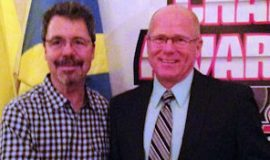 Former NASCAR driver Ernie Irvin congratulates Dick Barton on receiving the Top Gun Award at the Stateline Speedway banquet January 17, 2015. Barton retired as the all-time late model feature winner in the history of Stateline Speedway.