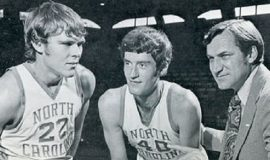 Donn Johnston, center,  with teammate George Karl (22) and North Carolina coach Dean Smith.