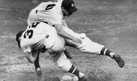 Irv Noren #32 Washington Senators bowls over Phil Rizzuto #10 NY Yankees to break up a double play in 1950