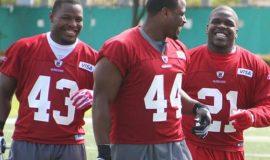 Jehuu Caulcrick (43), Moran Norris (44), Frank Gore (21) with the 2010 San Francisco 49ers. Photo credit 49ers.com.