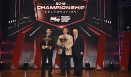 Championship Trophy flanked by driver Simon Pagenaud (left) and team owner Roger Penske (right).