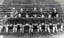 "Salvatore ""Jim"" Foti, captain, holding ball with Jamestown High School football team, 1930."