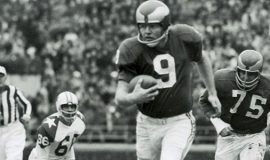 Jim McCusker is #75 behind quaterback Sonny Jurgeson #9 with the Philadelphia Eagles