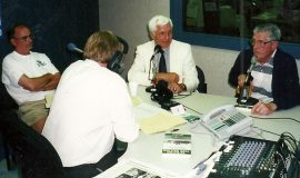 Jim Riggs, Russ Diethrick, John O'Neil being interviewed and Greg Peterson (back to camera).