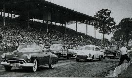 Rexford in Buesink's #60 1951 Olds (white car) on the pole at Canfield, OH, May 30, 1951.