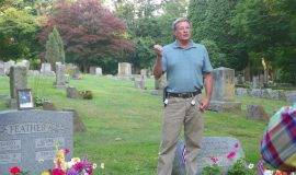 Mel Feather at his brother Dan Feather's gravesite.