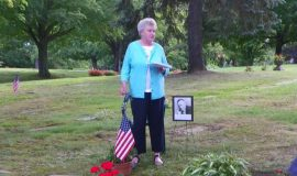 Sally Corkery at her father Clayt Webeck's gravesite.