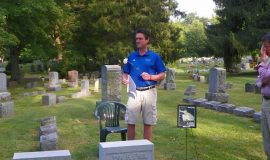 Scott Kindberg at John O'Neil's gravesite.