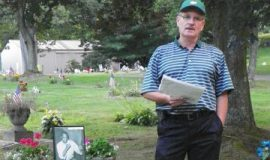 Tim Magnuson at Jimmy Clark's gravesite.