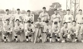 "1945 Jamestown Steel Partition Bombers. BACK ROW: Ralph Mee, Chan Wolfe, Kenny Vance, William Baker, Kenny ""Murph"" Johnson, Phil Newton, Lou Brown FRONT ROW: Roger DuBois, Ralph Bradigan, Les James, Harold ""Lefty"" Pratt, Rick Brown (batboy), Joe Nagle (manager), Jimmy Rodgers, Warren Mee, Don Nagle, Leo Squinn."