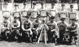 "1946 Jamestown Steel Partition Bombers. BACK ROW: Lou Brown, Laurie LaJohn, Bob Ingerson, Les James, Elly Norton, Harold ""Lefty"" Pratt, Ralph Mee, Bob Fredo FRONT ROW: Bob Brown, Bob Bender, Mark Hoskins, Frank Weller, Rick Brown (batboy), Les Town, Joe Nagle, Warren Mee."