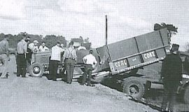 Lloyd Moore unloading his car from a coal truck in 1949.