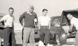 Lloyd Moore on far right unpacking his suitcase in the infield at Darlington Speedway (SC), 1952.