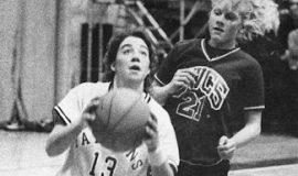 Lori Franchina playing basketball with Falconer High School.