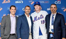Marc Tramuta, on right, stands beside Brett Baty.