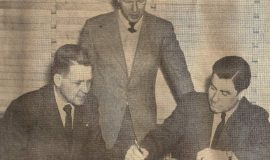 Marvin Olson signs the papers that made him manager of the Jamestown Falcons for 1946. Owner Johnny Jachym, seated left, looks on as does Business Manager Mark Hammond.