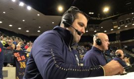 Mike Heary playing the color commentator role for Navy basketball games in 2019.