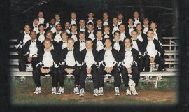 Nolan Swanson is front row center in this 1996-97 team photo. His brother Patrick is far right in the second row.