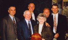 Martha Cooley, receiving a commemorative basketball from IAABO Board #39 for attending over 1,000 basketball games watching her husband Paul referee.