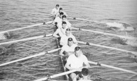 1957 undefeated Cornell varsity crew in their boat, Phil Gravink is the first oarsman, nearest the camera,facing the coxswain.