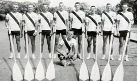 1957 Cornell crew team on land. Phil Gravink is on far left.