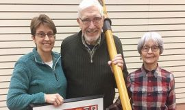 From left are Jill Gravink, Phil Gravink and Shirley Gravink donate an oar and a framed photograph from his memorabilia collection.