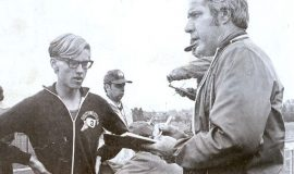 "Former Post-Journal sportswriter Sherwood ""Scrubby"" Olson, right, chats with Southwestern Central School track and field star Brian Hull after a meet at Fredonia State College, 1973."