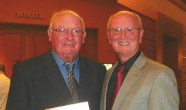 Skip Furlow (left), shown with Randy Anderson, receives Stateline Speedway Lifetime Achievement Award at 2012 Stateline banquet.