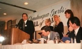 Chris Olsen accepts induction on behalf of his late father, Ted, at the 1999 banquet.