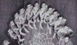 1950 Jamestown High School basketball team. Ted Olsen is directly in front of basket with glasses.