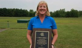 Tiffany Decker with her New York State Amateur Trap Association Hall of Fame plaque, 2018