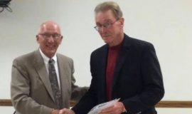 Tom Priester with Jeff Buchholz, president North East High School Athletic Hall of Fame.