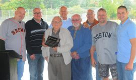 Joining in the dedication of the Little League field in Walt Brown's name are, from the left, Bradley Brown, grandson; Kris Brown, grandson; Arden Johnson, Town of Ellery supervisor; Tom Brown, son; Barry Brown, son; John Cresanti, Town of Ellery council member; Doug Brown, grandson; and Andy Brown, grandson. October 2018.