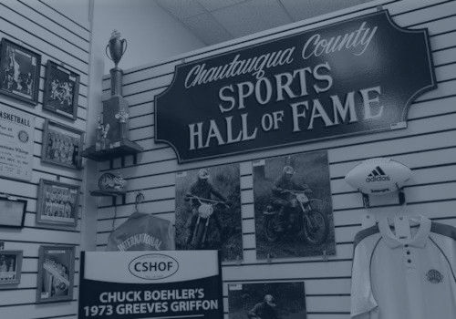 Photo of part of CSHOF exhibit hall interior featuring some of collected items