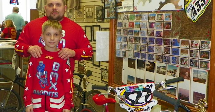 Jason Farrar and his son, Eric, atand in front of a collection of BMX bikes and related items they put on display at the exhibit hall in 2011.