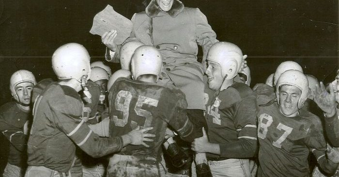 Dr. Harold Blaisdell is carried from the field by the Jamestown High School football team in this 1954 photo.