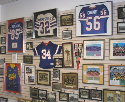 Donated photos, jerseys and other memorabilia are displayed on a wall in the exhibit hall.