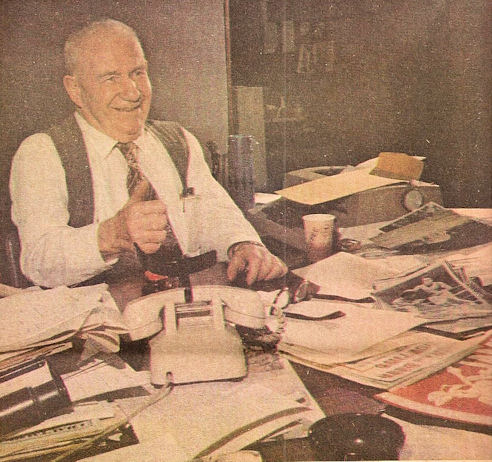 Frank Hyde at his desk before his retirement.